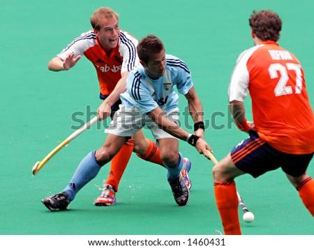 Field hockey match Netherland vs Argentina (blue) - stock photo