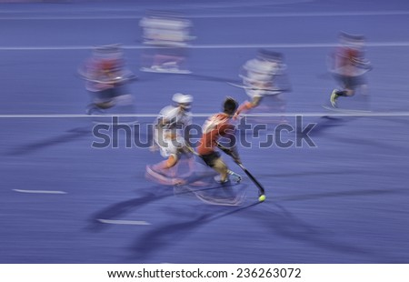 Field hockey players fight for a ball - stock photo