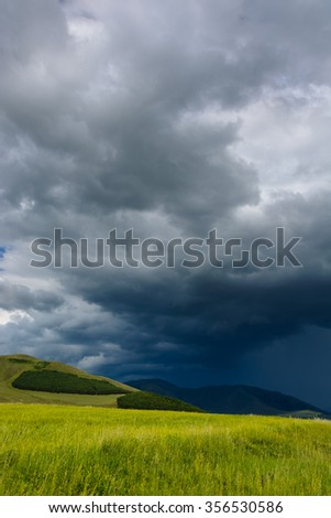 Field landscape with dramatic sky, Armenia - stock photo