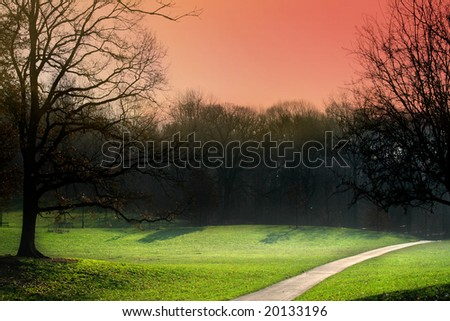 Field landscape with tree and colored sky - stock photo