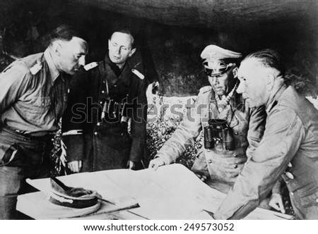 Field Marshal Erwin Rommel confers with his staff on the Libyan front, July 1942. He was fighting the British in the First Battle of El Alamein, July 1-27, 1942. - stock photo