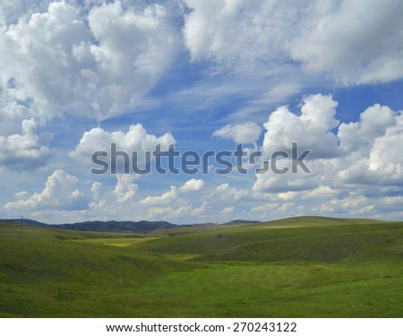Field of green grass and blue sky cloud - stock photo