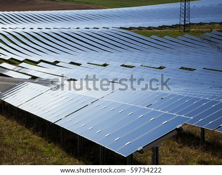 field of solar panels at photovoltaic power plant