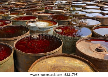 Field of waste toxic drums - stock photo