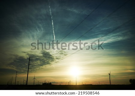 Field of windmill in colorful sunset