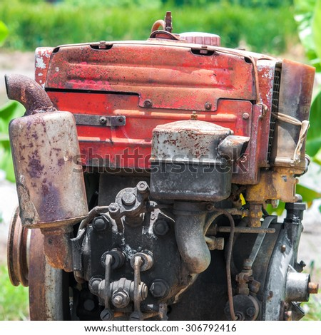field tractor in rice field - stock photo