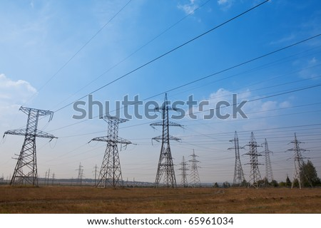 Field with a lot of power towers - stock photo