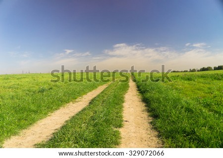 Fields of Sunlight Road and Nobody  - stock photo