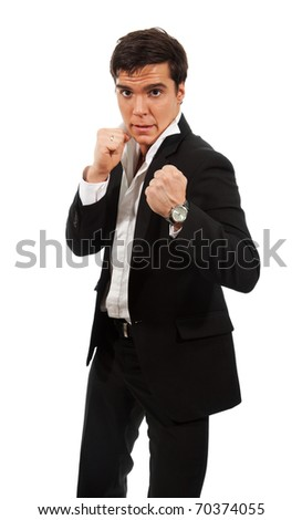 Fierce business - a man standing with fists and ready to fight - stock photo