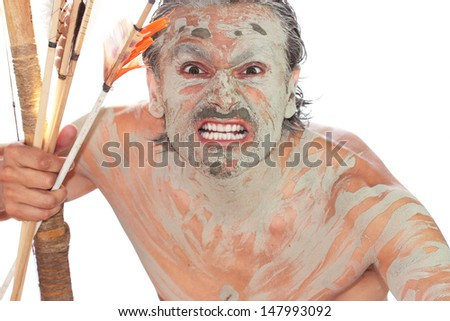 fierce facial expressions and grimaces of a primitive man - stock photo