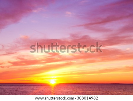 Fiery Backdrop Setting Sun  - stock photo