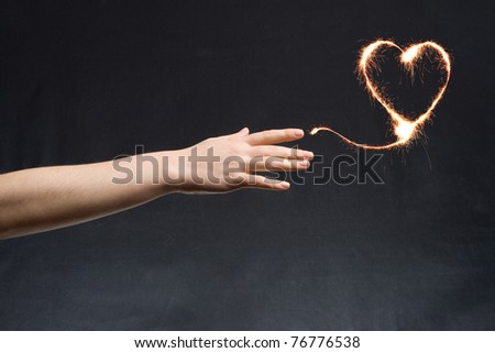 Fiery heart and hands of love. - stock photo