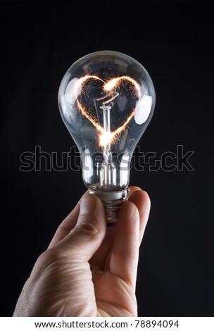 Fiery heart of an electric bulb - stock photo