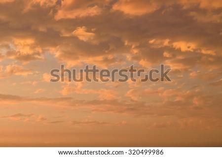 Fiery orange cloudscape, sundown background - stock photo