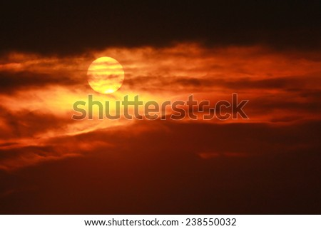 Fiery orange sunset sky dramatic golden sky in the evening  - stock photo
