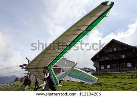 FIESH, SWITZERLAND - JULY 2: Competitor  is  taking  part in the Fiesh Open hang gliding competitions takes part on July 2, 2012 in Fiesh, Switzerland - stock photo