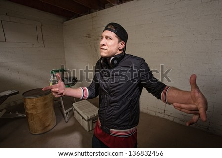 Fiesty cool European urban man with hand gestures - stock photo