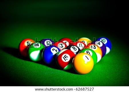 Fifteen billiard spheres lay on green cloth - stock photo