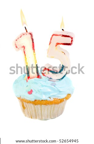 Fifteenth birthday cupcake with blue frosting on a white background
