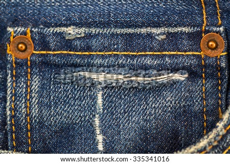 Fifth destroyed torn denim blue jeans pocket, close up fashion background - stock photo
