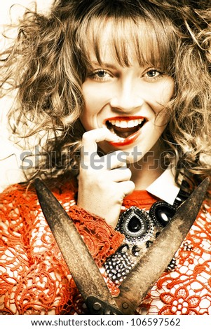 Fifties Fashion Photo Of A Young Brunette Woman With Curly Hair And Bright Red Makeup Holding Gardening Hedge Clippers In A Hairstyle And Hairdressing Concept - stock photo