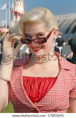 fifties vintage costume at Goodwood Revival event, UK - stock photo