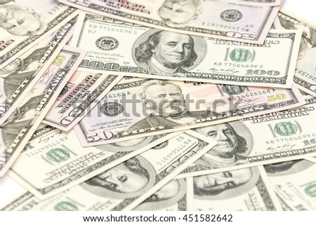 Fifty and one hundred dollars banknotes on the table - stock photo