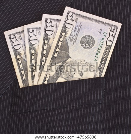 fifty dollar bills in a suit pocket - stock photo