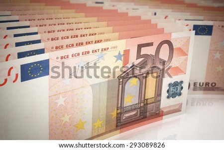 Fifty Euro banknotes close-up (depth of field) - stock photo