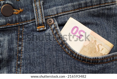 fifty euro in the front pocket of jeans - stock photo
