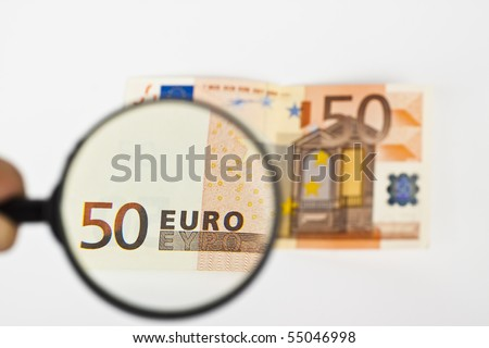 fifty  euro with magnifying glass on white background - stock photo