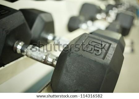 fifty kilos, close up fifty kilos of black iron dumbbell - stock photo