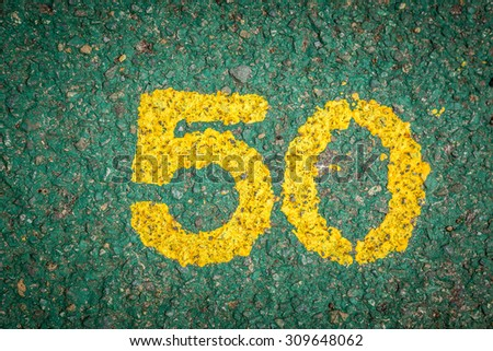 Fifty Number on Green cement background. - stock photo
