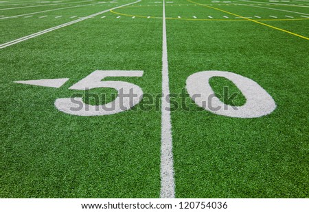 fifty yard line - football field - stock photo