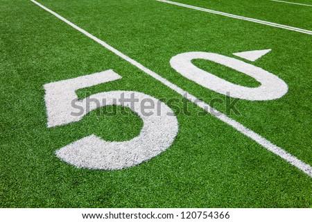 fifty yard line - football field - stock photo