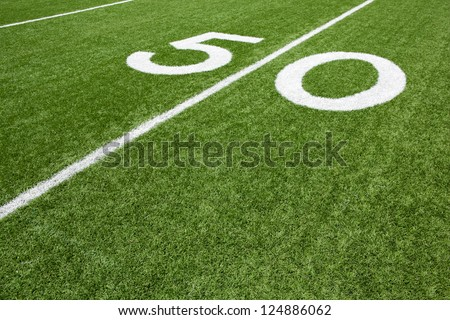 Fifty Yard Line of a Football Field with room for copy - stock photo