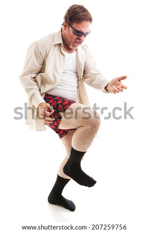 Fifty year old man in his underwear and sunglasses playing air guitar.  Isolated on white.   - stock photo