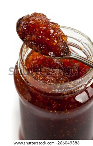 Fig Preserves on white background. Macro. Selective focus.