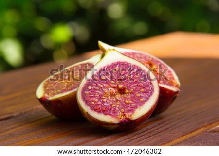 Fig slices on a brown wooden table