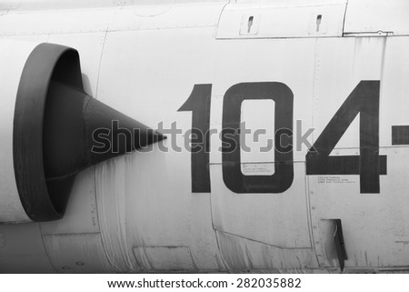Fighter aircraft fuselage metallic detail with number 104. Horizontal - stock photo