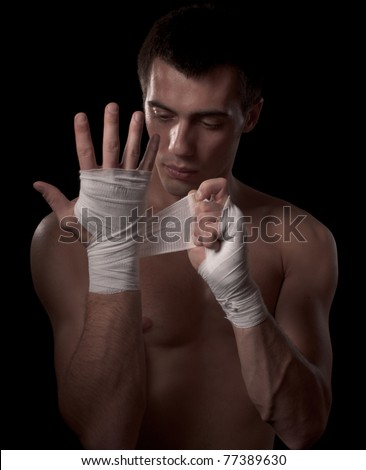 Fighter getting ready for fight, isolated on black - stock photo