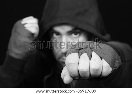 Fighter in concentration moment (focus in the face), B & W photo - stock photo