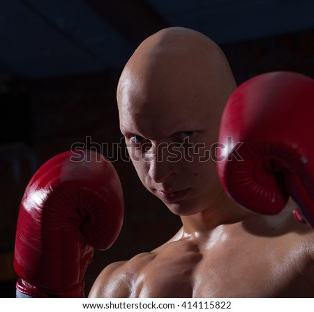 fighter in red gloves, close-up portrait