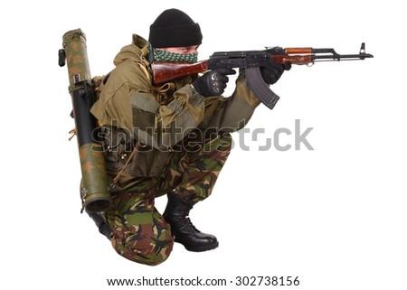 fighter with ak-47 rifle with kalashnikov rifle isolated on white background - stock photo