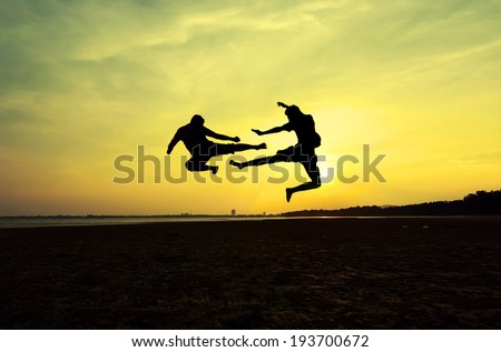 Fighting an enemy near the beach when the sun goes down - stock photo