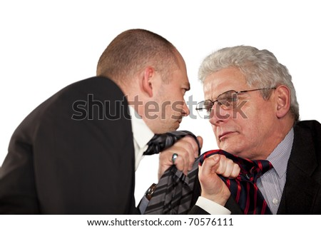fighting businessmen tearing each other at their ties - stock photo