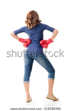 Fighting girl concept, rear view full length portrait of Asian isolated on white.
