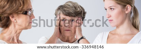 Fighting mother and daughter and confused grandmother - stock photo