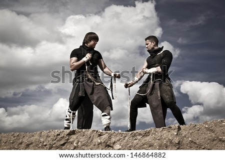 fighting of two athletic men - stock photo