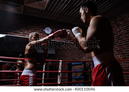 Fighting people in boxing ring